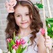 Portrait of a beautiful girl with tulips — Stock Photo