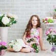 Portrait of a beautiful girl with flowers — Stock Photo