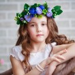 Portrait of a beautiful little girl in a wreath — Stock Photo