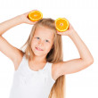 Beautiful girl with oranges — Stock Photo #25334243