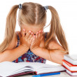 Tired little girl does homework — Stock Photo