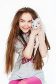 Girl playing with kitten — Stock Photo