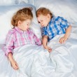 Two children asleep in bed — Stock Photo