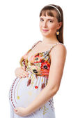 Portrait of a beautiful pregnant woman, isolated on white — Stock Photo