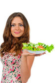 Girl holding a plate with salad — Stock Photo