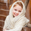 Beautiful girl in a fluffy shawl — Stock Photo