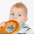 Little boy with bagel — Stock Photo