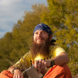 Hippie in the field — Stock Photo