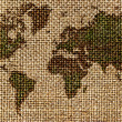 World map drawn on a rough,old fabrics — Stock Photo #32697329