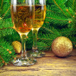 Wine glasses, Christmas toys, near New Year tree — Stock Photo #36220241