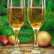 Wine glasses, Christmas toys, near New Year tree — Stock Photo