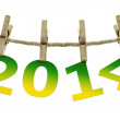 New year 2014, hanging on the clothesline on white background — Stock Photo