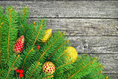 Christmas tree with a New Year toys on wood textur — Stock Photo