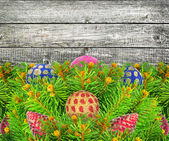 Christmas tree with a New Year toys on wood texture — Stock Photo