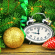 Christmas tree, watches, toys and wooden background. — Stock Photo #36997599