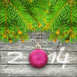Branches of Christmas tree on a wooden background. — Stock Photo