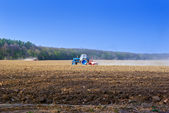 Tractor for agricultural work in a plowed field — Stock Photo