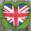 Union Jack, in the form of heart on a wooden background — Stock Photo #48045799
