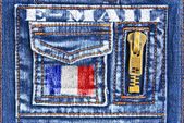 Material de denim com um bolso em forma de caixa de correio francês — Fotografia Stock