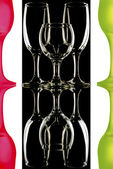 Colored wine glasses isolated on black and white background — Stock Photo