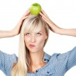 Woman with apple on head — Stock Photo #25802795