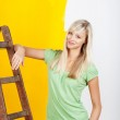 Woman renovating her house — Stock Photo #25803059