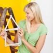 Woman renovating her house — Stock Photo