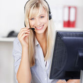 Blond call center operator — Stock Photo