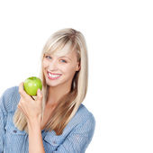 Smiling Woman with green apple — Stock Photo