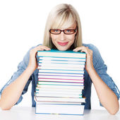 Young lady with stack of books — Stockfoto