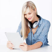 Woman with headphone and tablet — Foto de Stock