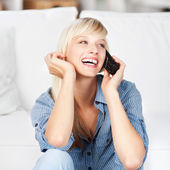 Laughing woman on phone — Stock Photo