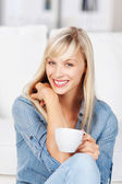 Woman relaxing with a cup of coffee — Stock Photo