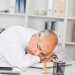 Mature Businessman Sleeping On Desk — Stock Photo #25825393
