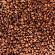 Natural flavored roasted coffee beans, high angle — Stock Photo #25828635