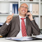 Businessman Using Phone While Gesturing Thumbs Up — Stock Photo
