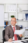 Businessman Holding Document While Looking Away — Stock Photo