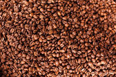 Natural flavored roasted coffee beans, high angle — Stock Photo
