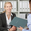 Stock Photo: BusinesswomWith Female Candidate In Office