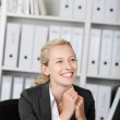 Smiling Young Blond Businesswoman — Stock Photo #25839619