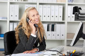 Smiling Businesswoman On Phone Looking Up — Stock Photo