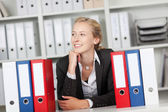 Businesswoman With Binders Sitting At Desk — Stock Photo