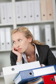 Bored Businesswoman With Binders — Stock Photo