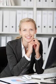 Smiling Young Businesswoman With Hands On Chin — Foto Stock
