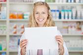 Female Pharmacist Holding Blank Paper — Stock Photo