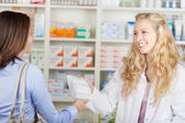 Pharmacist Giving Paperbag Of Medicine To Customer — Stock Photo