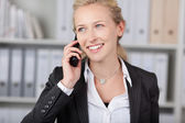 Smiling Businesswoman Using Mobile Phone — Stock Photo