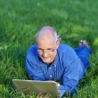 Businessman With Laptop Lying On Grass — Stock Photo