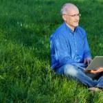 Man Using Laptop While Sitting On Grass — Stock Photo #25844885