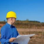 Male Architect Holding Blueprint — Stock Photo #25844897